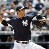 Photo - New York Yankees starting pitcher Hiroki Kuroda delivers in the first inning against the Detroit Tigers in a spring exhibition baseball game in Tampa, Fla., Wednesday, March 12, 2014. (AP Photo/Kathy Willens)