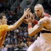 Photo - Washington Wizards' Marcin Gortat, right, of Poland, gets the balled stripped by Phoenix Suns' Goran Dragic (1), of Slovenia, during the first half of an NBA basketball game, Friday, Jan. 24, 2014, in Phoenix. (AP Photo/Ross D. Franklin)