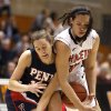 Photo - Penn guard Meghan McCullough, left, and Princeton forward Kristen Helmstetter compete for the ball during the first half of an NCAA college basketball game, Tuesday, March 11, 2014, in Princeton, N.J. (AP Photo/Julio Cortez)