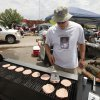 Derek Johnson, with the Riverton Friend\'s Church in Kansas, cooks burgers for residents and workers on the north perimeter of the tornado devastated part of Moore, OK, Thursday, May 23, 2013, Photo by Paul Hellstern, The Oklahoman