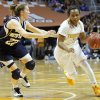Photo - Tennessee guard Ariel Massengale (5) drives against Notre Dame guard Madison Cable (22) in the first half of an NCAA college basketball game Monday, Jan. 20, 2014, in Knoxville, Tenn. (AP Photo/Wade Payne)