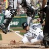 Detroit Tigers\' Alex Avila, right, slides under Chicago White Sox catcher A.J. Pierzynski to score from second base on a single by Andy Dirks in the second inning of a baseball game, Saturday, May 5, 2012, in Detroit. (AP Photo/Duane Burleson)