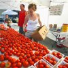 Barry Mize and Erica Hightower, 14, set out tomatoes at Mize\'s produce stant at the Farmer\'s Market, Cleveland County Fairgrounds, on Saturday, July 16, 2011, in Norman, Okla. Photo by Steve Sisney, The Oklahoman
