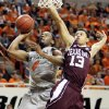 OSU\'s Brian Williams (4) takes a shot as Jordan Green (13) defends for Texas A&M in the first half of a men\'s college basketball game between the Oklahoma State University Cowboys and Texas A&M University Aggies at Gallagher-Iba Arena in Stillwater, Okla., Saturday, Feb. 25, 2012. OSU won, 60-42. Photo by Nate Billings, The Oklahoman