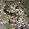 FILE - This aerial photo taken April 28, 2011 shows tornado damage in Pleasant Grove, Ala. The photos and mementoes that were blown for hundreds of miles during the tornado outbreak two years ago are giving researchers new insight on how debris is carried. University of Georgia associate professor John Knox says a new study has documented how one photo traveled nearly 220 miles through the atmosphere over Alabama and Tennessee. (AP Photo/Dave Martin, File)
