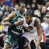 FILE - In this Jan. 20, 2013 file photo, then-Boston Celtics center Jason Collins (98) guards Detroit Pistons center Greg Monroe, right, in the second half of an NBA basketball game in Auburn Hills, Mich. Jason Collins has become the first male professional athlete in the major four American sports leagues to come out as gay. Collins wrote a first-person account posted Monday on Sports Illustrated\'s website. The 34-year-old Collins has played for six NBA teams in 12 seasons. He finished this past season with the Washington Wizards and is now a free agent. He says he wants to continue playing. (AP Photo/Duane Burleson, File)