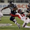 Nevada\'s Stefphon Jefferson (25) breaks a tackle from Fresno State\'s Phillip Thomas (16) during the first half of an NCAA college football game in Reno, Nev., on Saturday, Nov. 10, 2012. (AP Photo/Cathleen Allison) ORG XMIT: NVCA104
