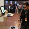 Photo - This Sept. 20, 2013 image released by Technical Illusions shows TextFiles.com founder and owner Jason Scott using the CastAR augmented reality 3D glasses in Portland, Ore. Wearable technology such as CastAR was among the topics discussed at the Game Developers Conference Next at the Los Angeles Convention Center on Nov. 5-7, 2013. (AP Photo/Technical Illusions/Jenesee Grey)