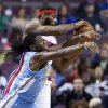 Detroit Pistons center Andre Drummond, top, grabs a rebound away from Denver Nuggets forward Kenneth Faried during the first half of an NBA basketball game on Saturday, Feb. 8, 2014, in Auburn Hills, Mich. (AP Photo/Duane Burleson)
