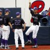 Photo - Washington baseball players joke around as they wait out a rain delay Friday afternoon, May 30, 2014, before playing the first baseball game against Georgia Tech during an NCAA college baseball regional tournament in Oxford, Miss. (AP Photo/Rogelio V. Solis)