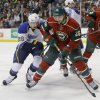 Photo - St. Louis Blues right wing Dmitrij Jaskin, left, of Russia, and Minnesota Wild left wing Matt Moulson chase the puck during the second period of an NHL hockey game in St. Paul, Minn., Thursday, April 10, 2014. (AP Photo/Ann Heisenfelt)