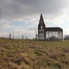 Photo - In this Feb. 20, 2013 file photo, a see-through church is pictured on a hilltop in Borgloon, 80 km (50 miles) East of Brussels. The artistic vision of the church is made of rusty steel beams separated by gaps, and its austere beauty won it an international architecture prize. Yet the eerie desolation of the see-through installation has also turned into a reflection on the state of Roman Catholicism on a religion-weary continent where real churches, like the dozen dotting the hills of this verdant area, increasingly lose their flock and function. (AP Photo/Yves Logghe, file)