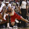Photo - Washington Wizards' Marcin Gortat, right, tries to steal the ball from Miami Heat's LeBron James (6) during the first half of an NBA basketball game in Miami, Sunday, Nov. 3, 2013. (AP Photo/J Pat Carter)