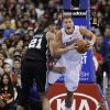 Los Angeles Clippers\' Blake Griffin, right, is fouled by San Antonio Spurs\' Tim Duncan during the first half of an NBA basketball game on Monday, Dec. 16, 2013, in Los Angeles. (AP Photo/Jae C. Hong)