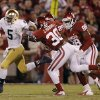 Notre Dame \'s Everett Golson (5) stiff arms OU\'s Javon Harris (30) during the college football game between the University of Oklahoma Sooners (OU) and the Notre Dame Fighting Irish at the Gaylord Family-Oklahoma Memorial Stadium on Saturday, Oct. 27, 2012, in Norman, Okla. Photo by Chris Landsberger, The Oklahoman