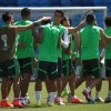 Photo - Mexico's soccer players warm up during a training session for the World Cup in the Arena das Dunas stadium in Natal, Brazil, Thursday, June 12, 2014.  (AP Photo/Sergei Grits)