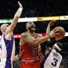 Chicago Bulls\' Carlos Boozer (5) tries to get a shot off as Phoenix Suns\' Marcin Gortat, left, of Poland, and Jared Dudley (3) defend during the first half of an NBA basketball game, Wednesday, Nov. 14, 2012, in Phoenix. (AP Photo/Ross D. Franklin)
