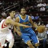 Houston Rockets\' Jeremy Lin, left, reaches for New Orleans Hornets\' Greivis Vasquez (21) in the first half of an NBA basketball game, Wednesday, Nov. 14, 2012, in Houston. (AP Photo/Pat Sullivan)