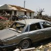 A car, house and other debris sit damaged in Granbury, Texas, on Friday May 17, 2013. On Wednesday, powerful storms produced 16 tornadoes in the area that left six dead. (AP Photo/Mike Fuentes)