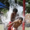 SUMMER / HOT WEATHER ART: Ten-year-old Bryson Carolina and his 6-year-old brother, J\'One Carolina, cool off in the splash park at Reed Park in Oklahoma City, OK, Tuesday, July 9, 2013, Photo by Paul Hellstern, The Oklahoman