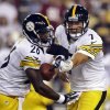 Photo - Pittsburgh Steelers quarterback Ben Roethlisberger (7) hands the ball off to running back Le'Veon Bell (26) during the first half of an NFL preseason football game against the Washington Redskins, Monday, Aug. 19, 2013, in Landover, Md. (AP Photo/Alex Brandon)