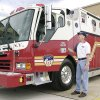 Retired Oklahoma City Assistant Fire Chief Jon Hansen with a rescue unit paid for by Oklahoma schoolchildren under the Spirit of Oklahoma Challenge in 2011. [PHOTO PROVIDED]