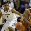 Kansas State guard Shane Southwell (1) reaches for the ball while covered by Texas guard Sheldon McClellan (1) during the first half of an NCAA college basketball game in Manhattan, Kan., Wednesday, Jan. 30, 2013. (AP Photo/Orlin Wagner)