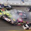 Tony Stewart (14) flips over as Kasey Kahne (5), Clint Bowyer (15), Terry Labonte (32), Regan Smith (78), Jeff Burton (31), Jimmie Johnson (48), Dale Earnhardt Jr., (88) Paul Menard (27) and David Ragan (34) crash around him during the NASCAR Sprint Cup Series auto race at Talladega Superspeedway in Talladega, Ala., Sunday, Oct. 7, 2012. (AP Photo/Dale Davis)