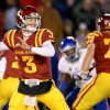 Photo - Iowa State quarterback Grant Rohach looks for an open receiver during the first half of an NCAA football game in Ames, Iowa Saturday Nov. 23, 2013. Rohach threw for 300 yards and two touchdowns in their 34-0 victory over Kansas. (AP Photo/ Justin Hayworth)