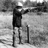 FILE - In this Sept. 6, 1928 file photo, U.S. President Calvin Coolidge shoots at clay pigeons at his vacation home on the Brule at Superior, Wis, He scored 29 out of 37. The White House has released a photo of President Barack Obama firing a gun, two days before he is set to travel to Minnesota to discuss gun control. It shows Obama shooting at clay targets on the range at Camp David, the presidential retreat in Maryland, where he says he engages in the sport