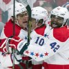 Photo - Washington Capitals' Alex Ovechkin, left, celebrates with teammates Martin Erat, center, and Joel Ward after Ovechkin scored against the Montreal Canadiens during the second period of an NHL hockey game in Montreal, Saturday, Jan. 25, 2014. (AP Photo/The Canadian Press, Graham Hughes)