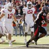 Texas Tech\'s Eric Stephens (24) rushes for a touchdown in front of OU\'s Austin Box (12) and Keenan Clayton (22) in the fourth quarter during the college football game between the University of Oklahoma Sooners (OU) and the Texas Tech University Red Raiders (TTU) at Jones AT&T Stadium in Lubbock, Texas, Saturday, Nov. 21, 2009. Texas Tech won, 41-13. Photo by Nate Billings, The Oklahoman