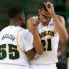 Photo -   Baylors Isaiah Austin, right, celebrates with Pierre Jackson, left, during a time out against Lehigh in the first half of an NCAA college basketball game on Friday, Nov. 9, 2012, in Waco, Texas. (AP Photo/Waco Tribune Herald, Rod Aydelotte)