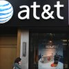 Photo -   FILE-In this May 6, 2012, file photo, a woman talks on her cell phone outside an AT&T store in New York. AT&T is seeing declining smartphone sales, leading to the best profitability ever in its wireless arm as it saves on phone subsidies. The largest telecommunications company in the U.S. says it activated 5.1 million smartphones in its latest quarter, down from 5.5 million in the same period a year ago. (AP Photo/CX Matiash,File)