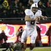 Stanford quarterback Kevin Hogan, right, is tackled by Oregon defender Taylor Hart during the first half of an NCAA college football game in Eugene, Ore., Saturday, Nov. 17, 2012.(AP Photo/Don Ryan)
