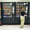 Photo - FILE - In this May 3, 2006 file photo, a student purchases a brown sugar Pop-Tart from a vending machine in the hallway outside the school cafeteria, in Wichita, Kan. High-calorie sports drinks and candy bars will be removed from school vending machines and cafeteria lines as soon as next year, replaced with diet drinks, granola bars and other healthier items the Agriculture Department said Thursday, June 27, 2013. (AP Photo/The Wichita Eagle, Mike Hutmacher, File)