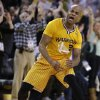 Golden State Warriors\' Jarrett Jack reacts after scoring against the San Antonio Spurs during the second half of an NBA basketball game Friday, Feb. 22, 2013, in Oakland, Calif. (AP Photo/Ben Margot)