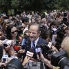 Photo - Former New York governor Eliot Spitzer is surrounded by media as he tries to collect signatures for his run for New York City Comptroller in New York, Monday, July 8, 2013. Spitzer, who stepped down in 2008 amid a prostitution scandal, says he is planning a political comeback with a run for New York City comptroller. (AP Photo/Seth Wenig)