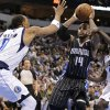 Dallas Mavericks\' Shawn Marion (0) and Darren Collison (4) defend against a drive to the basket by Orlando Magic\'s Jameer Nelson (14) during the first half of an NBA basketball game Wednesday, Feb. 20, 2013, in Dallas. (AP Photo/Tony Gutierrez)