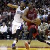 Photo - Miami Heat's Dwyane Wade (3) drives to the basket as Sacramento Kings' Rudy Gay (8) defends in the first half of an NBA basketball game, Friday, Dec. 20, 2013, in Miami. (AP Photo/Lynne Sladky)