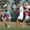 Michelle Wie, left, is doused by fellow players after winning the U.S. Women\'s Open golf tournament in Pinehurst, N.C., Sunday, June 22, 2014. (AP Photo/Chuck Burton)