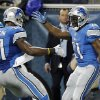 Photo - Detroit Lions wide receiver Calvin Johnson (81) congratulates running back Reggie Bush after Bush's 14-yard touchdown during the first quarter of an NFL football game against the Baltimore Ravens in Detroit, Monday, Dec. 16, 2013. (AP Photo/Duane Burleson)