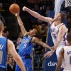 Oklahoma City\'s\' Cole Aldrich (45) blocks the shot of Dallas\' Jerome Randle (9) during a preseason NBA game between the Oklahoma City Thunder and the Dallas Mavericks at Chesapeake Energy Arena in Oklahoma City, Tuesday, Dec. 20, 2011. Photo by Bryan Terry, The Oklahoman