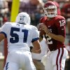 Oklahoma Landry Jones (12) looks through throw the ball past Air Force\'s Zach Payne (51) during the first half of the college football game between the University of Oklahoma Sooners (OU) and the Air Force Falcons at the Gaylord Family - Memorial Stadium on Saturday, Sept. 18, 2010, in Norman, Okla. Photo by Chris Landsberger, The Oklahoman