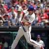 Photo - Philadelphia Phillies' Chase Utley hits a one-run single against the St. Louis Cardinals in the first inning of a baseball game Sunday, Aug. 24, 2014, in Philadelphia. (AP Photo/H. Rumph Jr)