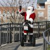 Photo - The Sonic Segway Santa waves to visitors in Bricktown in Oklahoma City, Friday December 13, 2013. Photo By Steve Gooch, The Oklahoman  Steve Gooch - The Oklahoman