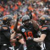COLLEGE FOOTBALL / BOWL GAME / CELEBRATION: Oklahoma State\'s Clint Chelf (10), Blake Jackson (18) and Austin Hays (84) celebrate a Jackson touchdown during the Heart of Dallas Bowl football game between Oklahoma State University (OSU) and Purdue University at the Cotton Bowl in Dallas, Tuesday,Jan. 1, 2013. Photo by Sarah Phipps, The Oklahoman