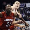 Connecticut\'s Breanna Stewart, right, and Louisville\'s Asia Taylor, left, look for a rebound during the second half of an NCAA college basketball game in the finals of the American Athletic Conference women\'s basketball tournament, Monday, March 10, 2014, in Uncasville, Conn. Connecticut won 72-52. (AP Photo/Jessica Hill)