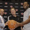 Photo -   Jason Kidd, left, and Marcus Camby, right, pose for a photograph with New York Knicks executive vice president and general manager Glen Grunwald after the team to introduced the pair as their newest players during a news conference at the team's NBA basketball training facility in Tarrytown, N.Y., Thursday, July 12, 2012. This is Camby's second stint as a member of the Knicks. (AP Photo/Kathy Willens)