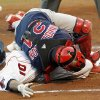 Memphis catcher Bryan Anderson (24) loses control of the ball as Oklahoma City\'s Jose Vallejo (10) slides home to score in the first inning during the minor league baseball game between the Memphis Redbirds and the Oklahoma City RedHawks at the Bricktown Ballpark in Oklahoma City, Friday, June 5, 2009. Photo by Nate Billings, The Oklahoman